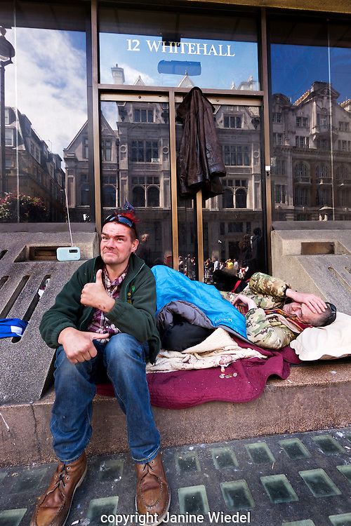 Two homeless men sleeping rough on Whitehall in Central London
