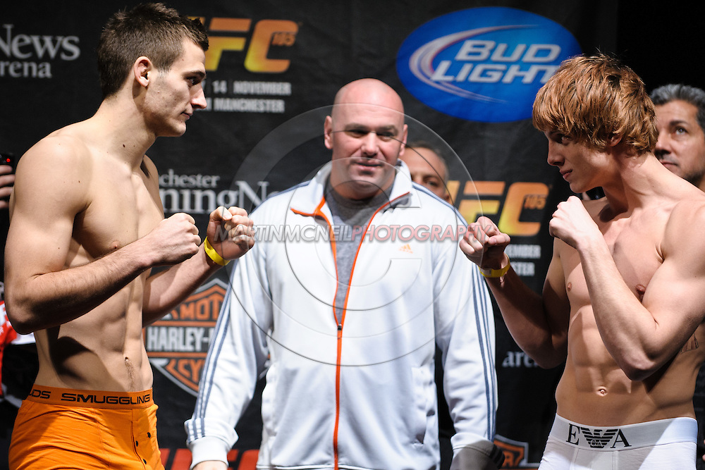 MANCHESTER, ENGLAND, NOVEMBER 13, 2009: Nick Osipczack (left) and Matthew Riddle face off during the weigh-ins for UFC 105 at the MEN Arena in Manchester, England on November 13, 2009.