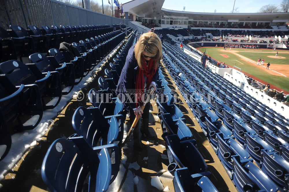 Ole Miss employees clear ice from the stands during the game at Stetson at Oxford-University Stadium in Oxford, Miss. on Saturday, March 7, 2015. Ole Miss won 8-3 in game 1 of a doubleheader to improve to 7-5.