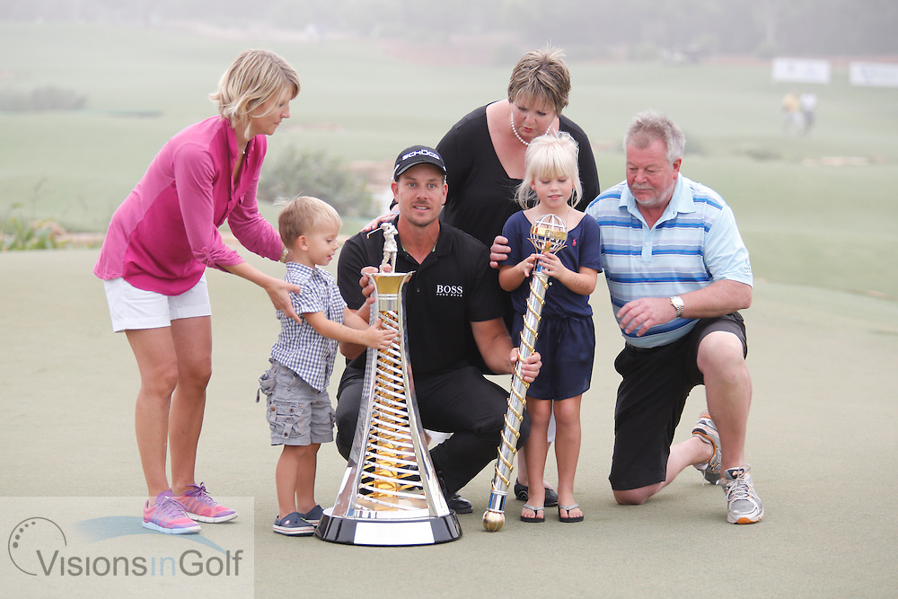 Henrik Stenson celebrates winning on the 18th with the trophy and his family wife and children<br /> during the last and final round of the Race To Dubai DP World Tour Golf Championship, Dubai, UAE November  2013<br /> Picture Credit:  Mark Newcombe / www.visionsingolf.com