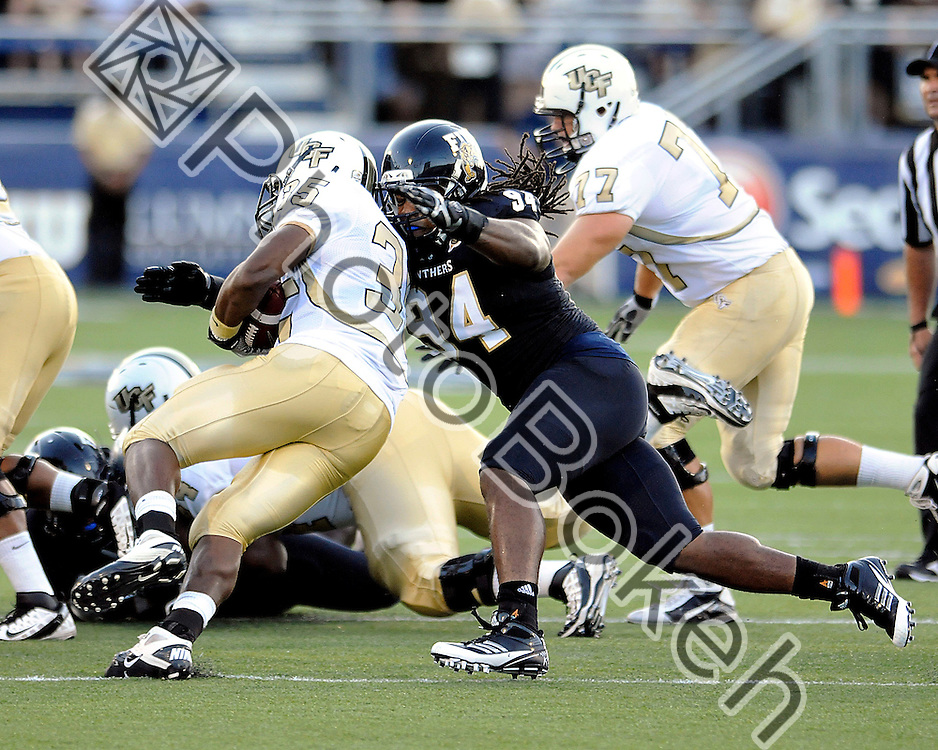 2011 September 17 - Florida International defensive line James Jones (94) tackling UCF running back Ronnie Weaver (35). Florida International University Golden Panthers defeated the Golden Knights of the University of Central Florida, 17-10, at the FIU Football Stadium, Miami, Florida. (Photo by: www.photobokeh.com / Alex J. Hernandez)