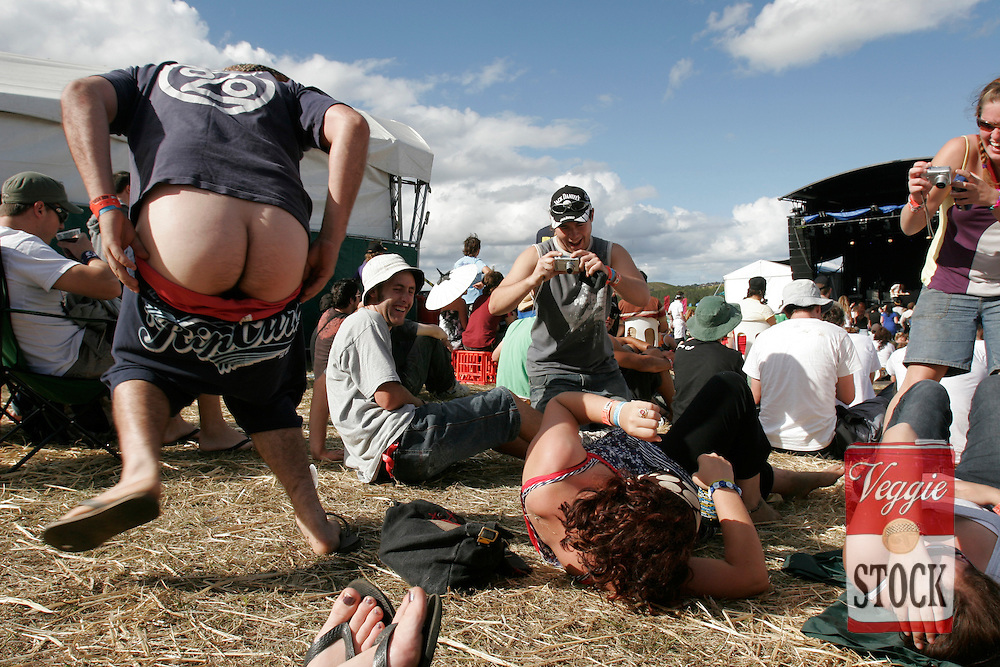 Friends entertain each other between bands at the Great Escape music festival in Sydney, Sunday, April 8, 2007. The festival is in its second year and runs over the Easter long weekend. (AAP Image/Megan Young) NO ARCHIVING