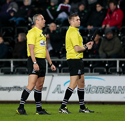 Referee John Lacey watches the replay<br /> <br /> Photographer Simon King/Replay Images<br /> <br /> European Rugby Champions Cup Round 5 - Ospreys v Saracens - Saturday 13th January 2018 - Liberty Stadium - Swansea<br /> <br /> World Copyright © Replay Images . All rights reserved. info@replayimages.co.uk - http://replayimages.co.uk