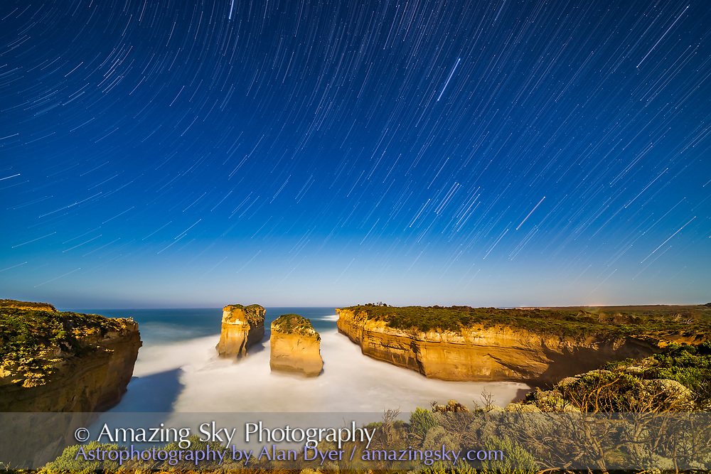 Orion (right) and Sirius (upper right) setting into the west over Loch Ard Gorge on the Great Ocean Road, Victoria, Australia, with illumination from the rising Moon a day past full behind the camera to the east. <br /> <br /> This is the location of the wreck of the Loch Ard immigrant ship, where only two survived by swimming ashore at this gorge and climbing the cliffs to find a ranch house nearby.<br /> <br /> This is a stack of 100 exposures for the sky and water, each 15 seconds, with the ground coming from one frame in the sequence to prevent the moving shadows from the rising Moon from blurring detail. <br /> <br /> All with the 14mm Rokinon lens at f/2.5 and Canon 6D at ISO 800. Stacked with Advanced Stacker Action Elastic Stars effect.