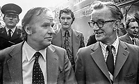 Stan Orme, minister of state, N Ireland Office, Stormont, Belfast, (left) visits Bangor, Co Down, N Ireland, surveying the massive damage caused by a Provisional IRA 15 bomb blitz on the town the previous day. He is accompanied by David Gilliland (with glasses) who is a press officer with the N Ireland Office. 197404040217d.<br /> <br /> Copyright Image from Victor Patterson,<br /> 54 Dorchester Park, <br /> Belfast, UK, BT9 6RJ<br /> <br /> t1: +44 28 9066 1296 (from Rep of Ireland 048 90661296)<br /> t2: +44 28 9002 2446 (from Rep of Ireland 048 9002 2446)<br /> <br /> m: +44 7802 353836<br /> <br /> e: victorpatterson@me.com<br /> www.victorpatterson.com<br /> <br /> Please see my Terms and Conditions of Use at www.victorpatterson.com. It is IMPORTANT that you familiarise yourself with them.<br /> <br /> Images used on the Internet must be visibly watermarked i.e. © Victor Patterson<br /> within the body of the image and copyright metadata must not be deleted. Images <br /> used on the Internet have a size restriction of 4kbs and will be chargeable at current<br />  NUJ rates unless agreed otherwise.<br /> <br /> This image is only available for the use of the download recipient i.e. television station, newspaper, magazine, book publisher, etc, and must not be passed on to any third <br /> party. It is also downloaded on condition that each and every usage is notified within 7 days to victorpatterson@me.com<br /> <br /> The right of Victor Patterson to be identified as the author is asserted in accordance with The Copyright Designs And Patents Act (1988). All moral rights are asserted