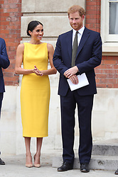 July 5, 2018 - London, London, United Kingdom - Image licensed to i-Images Picture Agency. 05/07/2018. London, United Kingdom. The Duke and Duchess of Sussex  meet youngsters from across the Commonwealth as they attend the Your Commonwealth Youth Challenge reception at Marlborough House in London. (Credit Image: © Pool/i-Images via ZUMA Press)