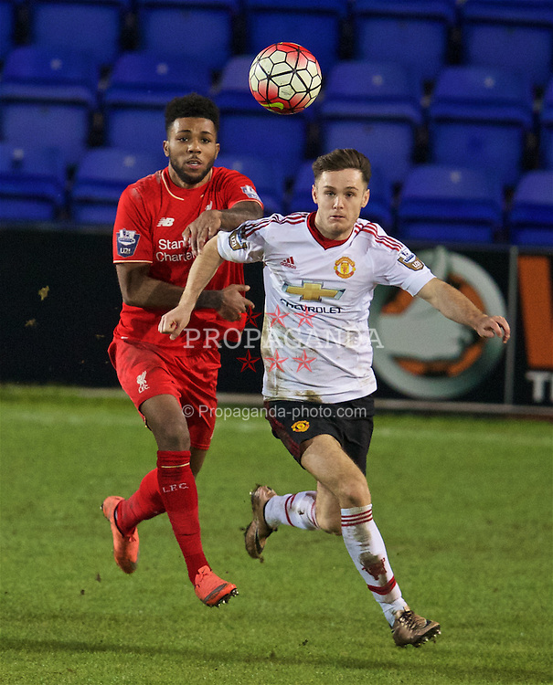 BIRKENHEAD, ENGLAND - Friday, March 11, 2016: Liverpool's Jerome Sinclair in action against Manchester United's Joe Riley during the Under-21 FA Premier League match at Prenton Park. (Pic by David Rawcliffe/Propaganda)