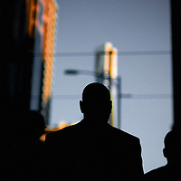 Silhouette of man in street against high rise buildings