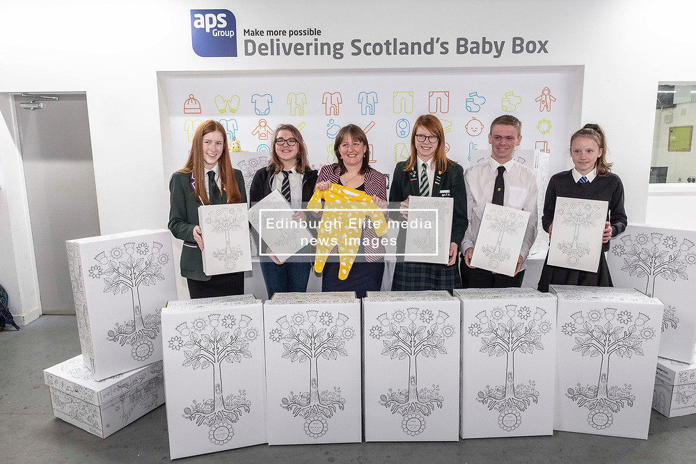Pictured: Emily Wilson, (15) St Luke's High School Barrhead, Demi Burnett, (12) Banff Academy in Macduff, Holly Henry, (16) St Colkumba's Kilmacom, Maree Todd, Soinny Robertson,(17) Trinity Academy Edinburgh and Edith Macdonald, (13) Community School of Auchterarder.<br /><br />Children's Minister Maree Todd visited the APS distribution centre in Edinburgh where the baby boxes are printed, filled and distributed, to meet the young people behind the new baby box design.  The winning design was created by young people from Macduff, Auchterarder, Barrhead, Kilmacolm and Edinburgh as a result of a nationwide Young Scot competition celebrating the Year of Young People.<br /><br />Ms Todd presented an award to the winning design team and unveiled the redesigned baby box.<br /><br /><br />Ger Harley | EEm 27 March 2019