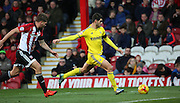 Nottingham Forest striker Nelson Oliveira with a shot on goal in a closely fought contest during the Sky Bet Championship match between Brentford and Nottingham Forest at Griffin Park, London, England on 21 November 2015. Photo by Matthew Redman.