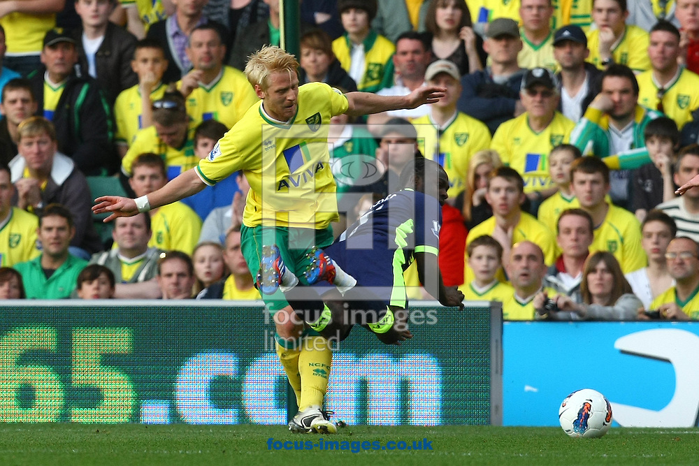 Picture by Paul Chesterton/Focus Images Ltd.  07904 640267.11/03/12.Victor Moses of Wigan and Zac Whitbread of Norwich in action during the Barclays Premier League match at Carrow Road Stadium, Norwich.