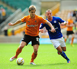 Wolverhampton Wanderers Kevin Doyle battles for the ball with Leicester City's Daniel Drinkwater - Photo mandatory by-line: Joe Meredith/Josephmeredith.com  - Tel: Mobile:07966 386802 16/09/2012 - Wolves v Leicester City - SPORT - FOOTBALL - Championship -  Wolverhampton  -  Molineux Stadium  -