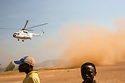 Photo of Kayanza soccer field landing pad today in kayanza 6 july 2005. pakistani helicpoter pilot picking up staff after day in the field for payment to the burudian peacekeepers and militant combattants. 6 July 2005.ONUB/Martine Perret