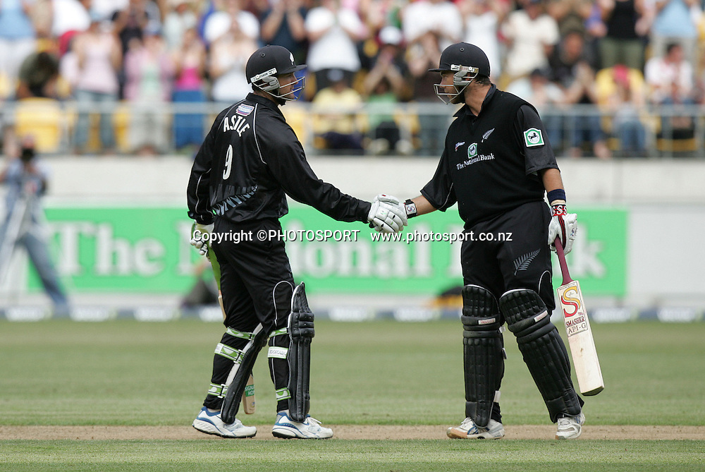 Black caps Nathan Astle (L) gets congratulated for his 100 runs by team mate Brendan McCullum during the second one day International match between New Zealand and the FICA World XI on Monday 24 January, 2005 at Westpac Stadium, Wellington, New Zealand. A portion of donations made will help fund countries hit by the Boxing Day Tsunami.<br />PHOTO: Photosport