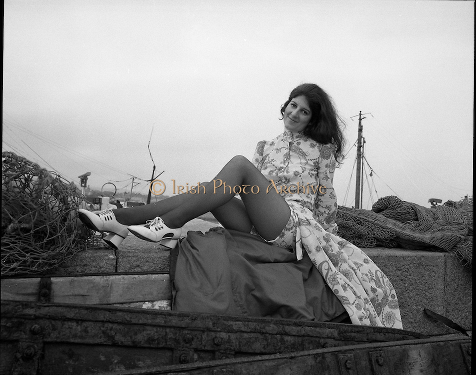 """Miss """"World Fishing"""" 1971..1971..13.03.1971..03.13.1971..13th March 1971..To present the more glamorous side of the fishing industry B.I.M. (Bord Iascaigh Mhara) organised a Miss World style competition for young women within the fishing industry.The winner, selected from six finalists from fishing ports around the country, will represent B.I.M. at the forthcoming World Fishing Exhibition to be held in Ireland. The winner will receive an all expenses paid trip to Paris for two courtesy of Normandy Ferries and a complete ensemble from """"Open Till Eight"""" fashions..Pictured is the winner of the """"Miss World Fishing"""" competition, Ms Ann Scallan,Kilmore Quay,Co. Wexford. She is pictured wearing part of the ensemble supplied by """"Open Till Eight' fashions. In her official capacity, as """"Miss World Fishing"""",she will present the glamorous side of Irish Fishing to the many foreign delegates expected at The World Fishing Exhibition."""