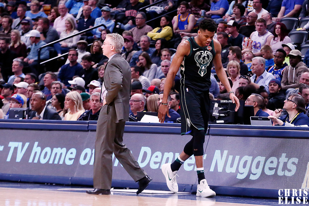 01 April 2018: Milwaukee Bucks head coach Joe Prunty is seen next to Milwaukee Bucks forward Giannis Antetokounmpo (34) during the Denver Nuggets 128-125 victory over the Milwaukee Bucks, at the Pepsi Center, Denver, Colorado, USA.