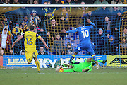 Oxford United goalkeeper Simon Eastwood (1) saving from AFC Wimbledon striker Dominic Poleon (10) during the EFL Sky Bet League 1 match between AFC Wimbledon and Oxford United at the Cherry Red Records Stadium, Kingston, England on 14 January 2017. Photo by Matthew Redman.