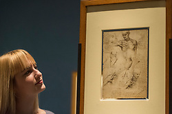 "© Licensed to London News Pictures. 28/02/2019. LONDON, UK. A staff member views ""The Anatomy of the Shoulder and Neck"" c1510-11 by Leonardo da Vinci. Preview of ""The Renaissance Nude"", an exhibition at the Royal Academy of Arts in Piccadilly of 90 works examining the emergence of the nude in European art.  Works by artists including Leonardo da Vinci to Michelangelo are on display in the Sackler Galleries 3 March to 2 June 2019.  Photo credit: Stephen Chung/LNP"