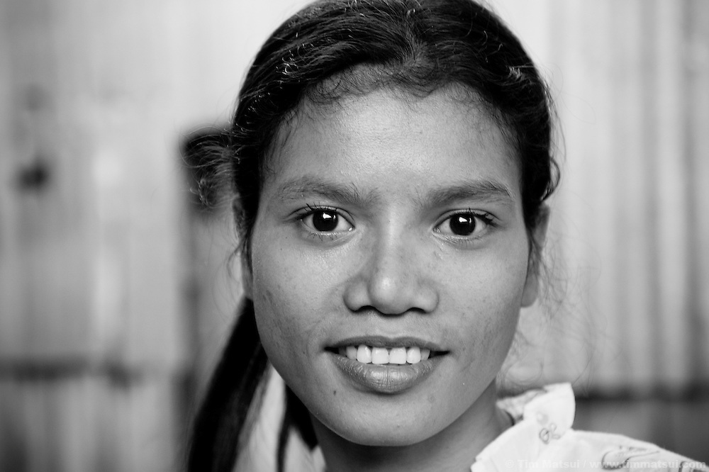 """Srey Bee, a prostitute living in a slum where """"Acting for Women in Distressing Situations"""" (AFESIP) conducts outreach and provides services, in Phnom Penh, Cambodia. The slum's permanent structure, a decaying four story building known simply as 'The Building', was built in the 1960's as transitional housing and now hosts a shantytown where many of the city's poor live, including many prostitutes, and is believed to have the highest rate of HIV infection in the city. AFESIP hands out free condoms, instructs prostitutes on HIV prevention, and conducts outreach in case the prostitutes need medical services, choose to leave their profession, or can report on cases of sex trafficking. AFESIP offers housing, education, training, and counseling for women who are victims of sex trafficking, worked as prostitutes, or are escaping domestic violence. Founded by Somaly Mam, who herself was once a prostitute and victim of trafficking and domestic abuse, AFESIP has three facilities in Cambodia and works with other NGO's to provide long term care for the women."""
