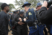 During the protest in Jena Louisana on Martin Lurther King holiday, State police clash with members of the New Black Panthers Party outside the LaSalle County Parish Courthouse Monday Jan. 21,2008.(photo/©SuziAltman) A group of protesters march to Jena High School on the Martin Luther King Jr. holiday in Jena, La., Monday, Jan. 21, 2008. The protest was organized by the self-described 'pro-majority' Nationalist Movement of Learned, Mississippi, lead by Richard Barrett, and was being held in opposition to the six black teenagers who were arrested in the beating of a white classmate in December 2006, and the King holiday. The protest drew about 50 participants and 100 counter-demonstrators to Jena.(Photo/© Suzi Altman)