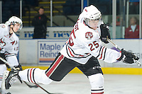 KELOWNA, CANADA, NOVEMBER 9: Marc McCoy #25 of the Red Deer Rebels takes a shot on net during warm up as the Red Deer Rebels visit the Kelowna Rockets  on November 9, 2011 at Prospera Place in Kelowna, British Columbia, Canada (Photo by Marissa Baecker/Shoot the Breeze) *** Local Caption ***