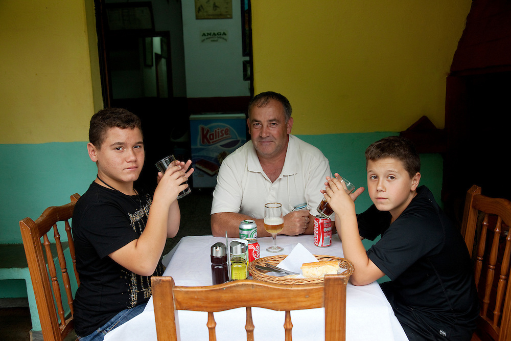 Father and sons enjoy lun at CASA CARLOS restaurant ANAGA MOUNTAINS, Tenerife.