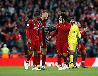 Football - 2018 / 2019 Premier League - Liverpool vs. Tottenham Hotspur<br /> Georginio Wijnaldum, Jordan Henderson and Mohamed Salah of Liverpool celebrate in front of the Kop after Liverpool take the three points, at Anfield.<br /> <br /> COLORSPORT/ALAN MARTIN