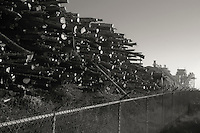Lumber stacked for milling at one of last operating lumber mills in Eureka, CA.  Copyright 2009 Reid McNally.