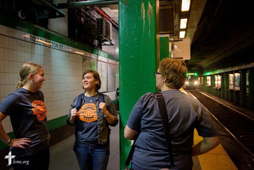 Young Adult Corps participants (L-R) Coretta Hedstrom, Rachel McCloskey, and Laura Grundeman wait for the subway on Wednesday, Oct. 25, 2017, in Boston. LCMS Communications/Erik M. Lunsford