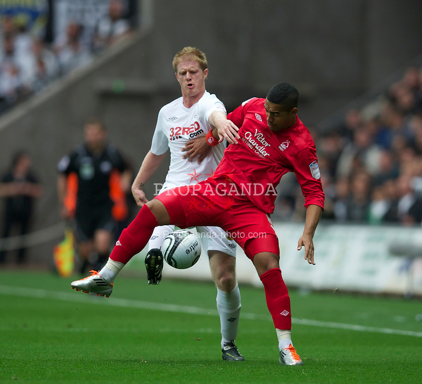 SWANSEA, WALES - Monday, May 15, 2011: Swansea City's Alan Tate and Nottingham Forest's Lewis McGugan during the Football League Championship Play-Off Semi-Final 2nd Leg match at the Liberty Stadium. (Photo by David Rawcliffe/Propaganda)