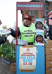 LONDON, ENGLAND - Saturday, January 2, 2016: A programme seller outside Upton Park before the Premier League match between Liverpool and West Ham United. (Pic by David Rawcliffe/Propaganda)