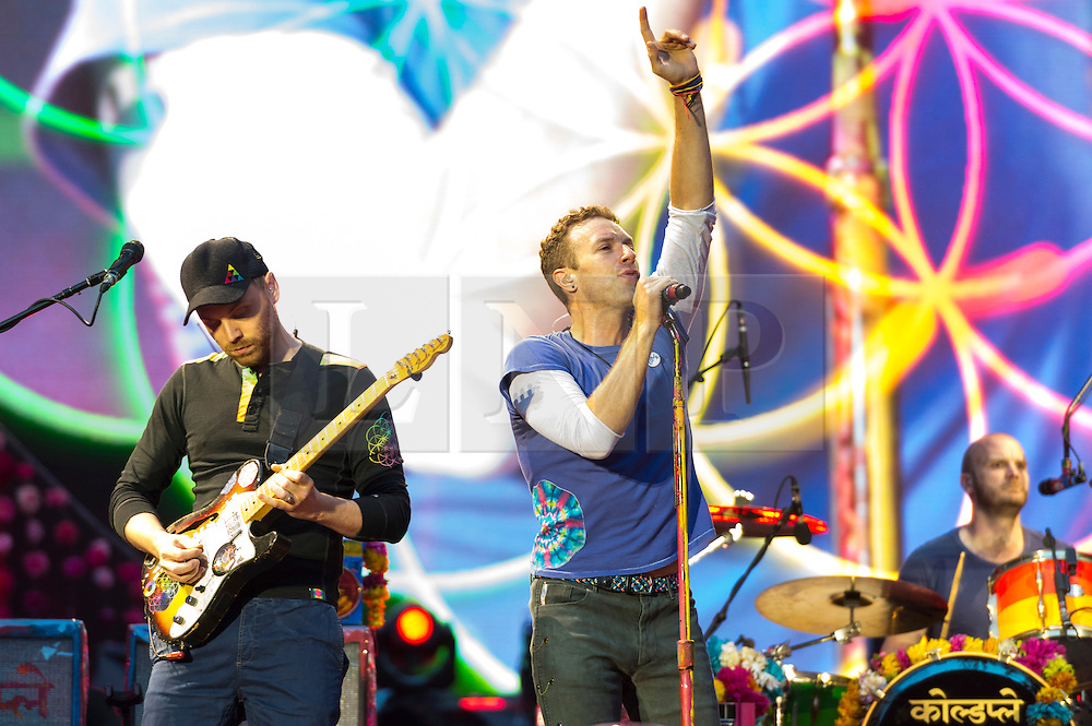 © Licensed to London News Pictures. 15/06/2016.  Coldplay members JONNY BUCKLAND, WILL CHAMPION and CHRIS MARTIN play at Wembley Stadium during their Handful of Dreams World tour.<br /> <br /> Please note this supplied photo is for editorial usage only and cannot be used for merchandise.  This supplied photo must be deleted and withdraw from usage on 14th September 2016 as agreed by Coldplay management.  London, UK. Photo credit: Ray Tang/LNP