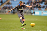Bury Midfielder Andrew Tutte shoots during the Sky Bet League 1 match between Coventry City and Bury at the Ricoh Arena, Coventry, England on 13 February 2016. Photo by Dennis Goodwin.
