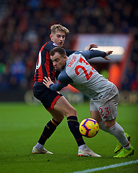 BOURNEMOUTH, ENGLAND - Saturday, December 8, 2018: AFC Bournemouth's David Brooks (L) and Liverpool's Xherdan Shaqiri during the FA Premier League match between AFC Bournemouth and Liverpool FC at the Vitality Stadium. (Pic by David Rawcliffe/Propaganda)