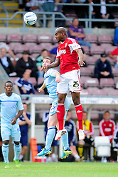 Bristol City's Marvin Elliott wins a header against Coventry City's John Fleck - Photo mandatory by-line: Dougie Allward/JMP - Tel: Mobile: 07966 386802 11/08/2013 - SPORT - FOOTBALL - Sixfields Stadium - Sixfields Stadium -  Coventry V Bristol City - Sky Bet League One