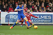 AFC Wimbledon defender Sean Kelly (22) tackling Walsall midfielder Erhun Oztumer (10) during the EFL Sky Bet League 1 match between AFC Wimbledon and Walsall at the Cherry Red Records Stadium, Kingston, England on 25 February 2017. Photo by Matthew Redman.