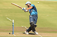 Albie Morkel takes a hit on the viser during the first leg of the semi-final in the Standard Bank Pro20 series between the Nashua Mobile Cape Cobras and the Nashua Titans played at Sahara Park Newlands in Cape Town, South Africa on 27 February 2011. Photo by Jacques Rossouw/SPORTZPICS