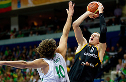 Simas Jasaitis of Lithuania vs Robin Benzing of Germany during basketball game between National basketball teams of Lithuania and Germany at FIBA Europe Eurobasket Lithuania 2011, on September 11, 2011, in Siemens Arena,  Vilnius, Lithuania. (Photo by Vid Ponikvar / Sportida)