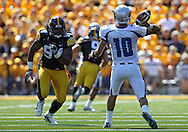 September 4 2010: Eastern Illinois Panthers quarterback Brandon Large (10) throws a pass as Iowa Hawkeyes defensive end Adrian Clayborn (94) closes in during the second quarter of the NCAA football game between the Eastern Illinois Panthers and the Iowa Hawkeyes at Kinnick Stadium in Iowa City, Iowa on Saturday September 4, 2010. Iowa defeated Eastern Illinois 37-7.
