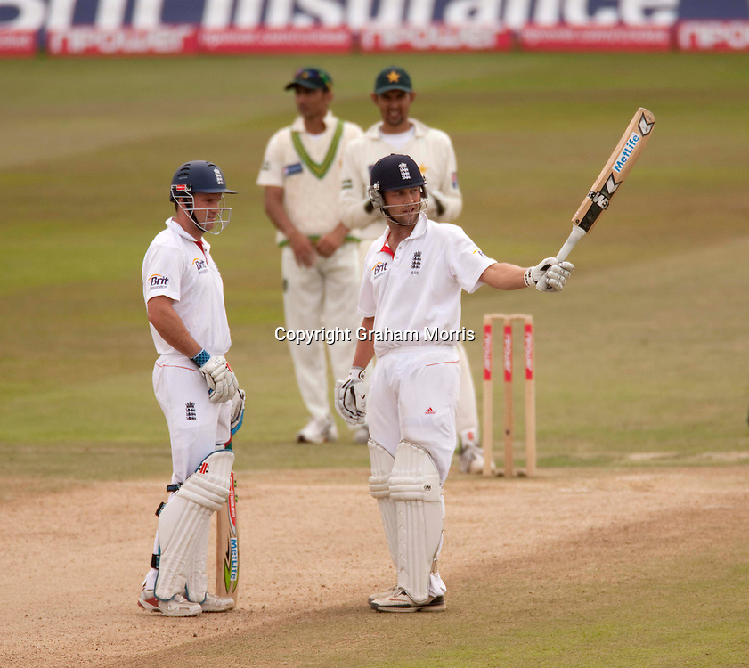Andrew Strauss (left) as Jonathan Trott celebrates his half-century during the second npower Test Match between England and Pakistan at Edgbaston, Birmingham.  Photo: Graham Morris (Tel: +44(0)20 8969 4192 Email: sales@cricketpix.com) 09/08/10