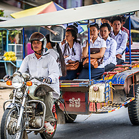 Jan 3, 2013 - Goods of all sorts are transported by two wheels. Here school children move by motorcycle pulled trailor in the Cambodian capital city of Phnom Penh.<br /> <br /> Story Summary: Amidst the feverish pace of Phnom Penh&rsquo; city streets, a workhorse of transportation for people and goods emerges: Bicycles, motorcycles, scooters, Mopeds, motodups and Tuk Tuks roam in place of cars and trucks. Almost 90 percent of the vehicles roaming the Cambodian capital of almost 2.3 million people choose these for getting about. Congestion and environment both benefit from the small size and small engines. Business is booming in the movement of goods and and another one million annual tourists in Cambodia&rsquo;s moto culture.