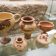 Various decorated jars from the period 1400-1200 BC. The Stoa of Attalos is a 1950s recreation of a long pavilion that was originally built around 150 BC. It was part of the Ancient Agora (market). It now houses the Museum of the Ancient Agora, which includes clay, bronze and glass objects, sculptures, coins and inscriptions from the 7th to the 5th century BC, as well as pottery of the Byzantine period and the Turkish conquest.