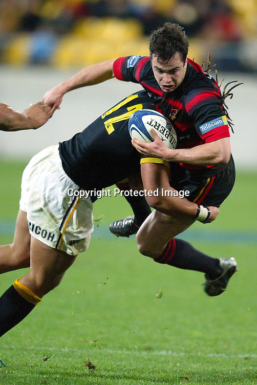 13 August 2004, Westpac Stadium, Wellington, <br /> New Zealand, Rugby Union, NPC Div 1<br /> Wellington Lions vs Canterbury<br /> Lion's Ma'a Nonu lifts Canterbury's Joel Lggo into the air in a tackle during Wellington's 34-22 win over Canterbury on Friday night.<br /> Please Credit: Marty Melville/Photosport