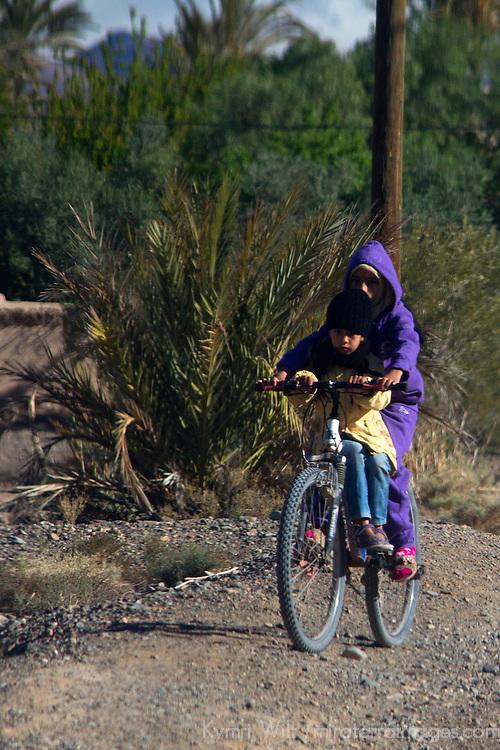 Africa, Morocco, Skoura. Moroccan Locals on bike near Skoura.