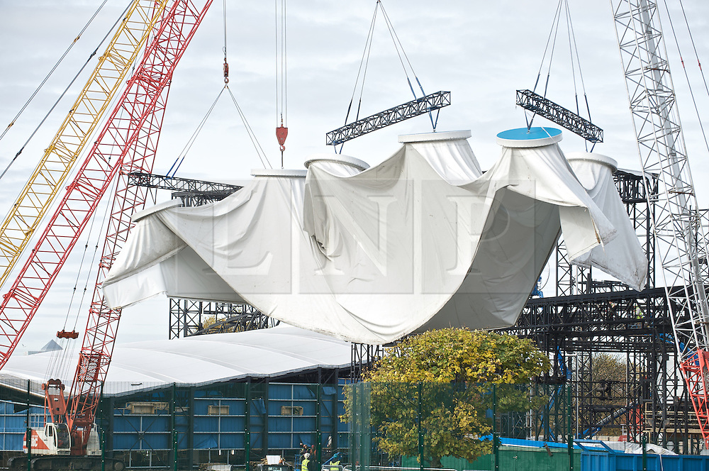© Licensed to London News Pictures. 13/11/2012. Woolwich, UK. The fabric skin is removed from a structure at the Woolwich Olympic shooting venue.  Designed by Magma Architecture of London and Berlin, the Olympic Shooting Venue comprised three PVC tents that were erected at London's historic Royal Artillery Barracks in Woolwich.Photo credit : Warren King/LNP