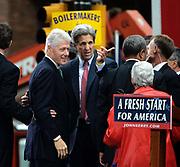 Philadelphia, Pennsylvania, USA, October 25th 2004: Presidential hopeful Senator John Kerry gets some help from former President Bill Clinton during a rally in Love Park in Philadelphia.