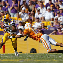 Oct 2, 2010; Baton Rouge, LA, USA; LSU Tigers wide receiver Russell Shepard (10) runs past Tennessee Volunteers cornerback Janzen Jackson (15) during the first half at Tiger Stadium.  Mandatory Credit: Derick E. Hingle
