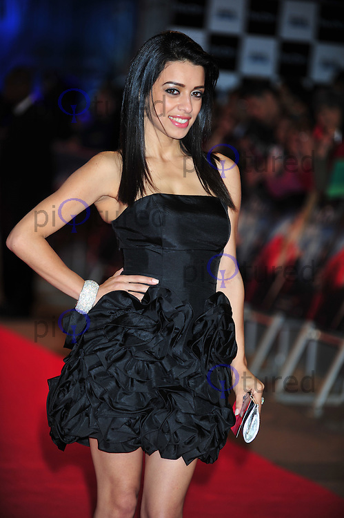 Jasmin May attends the UK premiere of RA One , the first Bollywood film released in the UK in 3D at the O2 in London . Photo credit should read ALAN ROXBOROUGH /Piqtured