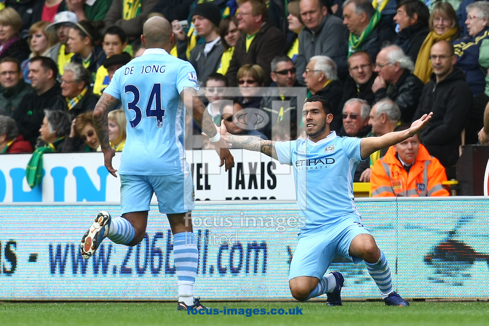 Picture by Paul Chesterton/Focus Images Ltd.  07904 640267.14/04/12.Carlos Tévez of Man City opens the scoring and celebrates during the Barclays Premier League match at Carrow Road Stadium, Norwich.