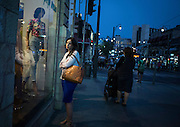A woman window shops Thursday, June 19, 2014 in Jerusalem, Israel. (Brian Cassella/Chicago Tribune)  B583846463Z.1<br /> ....OUTSIDE TRIBUNE CO.- NO MAGS,  NO SALES, NO INTERNET, NO TV, CHICAGO OUT, NO DIGITAL MANIPULATION...